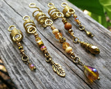 A close up view of a Set of 5 Gold Amber Loc Beads.