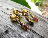 Amber and gold dread bead set of 3 displayed on wood background