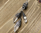 Silver Crystal Dread Bead, Ivory Inclusions on wood background.