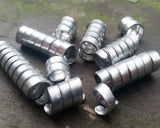 Set of 10 varied length aluminum dread beads in pile