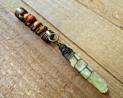 Green Kyanite, Hematite Dread Bead on wood background.