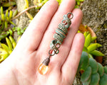 Woven Copper Patina and Citrine Dread Bead in hand to show scale.