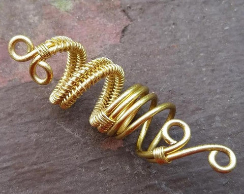 Close up of Artisan Woven Dread Bead