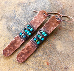 A top view of Turquoise Hammered Copper Earrings.