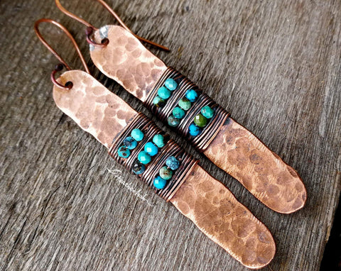A close up view of Turquoise Hammered Copper Earrings.