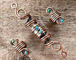 A top view of Copper Turquoise Dread Beads Set of 3.