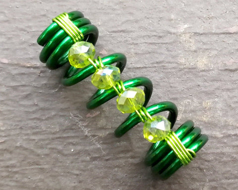 A close up view of a Green Dread Bead.