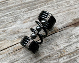 A top view of a Hematite Loc Bead.