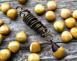A close up view of a Yellow Jasper Dread Bead.
