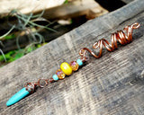 Side view of Bohemian Loc Bead on a wooden background.
