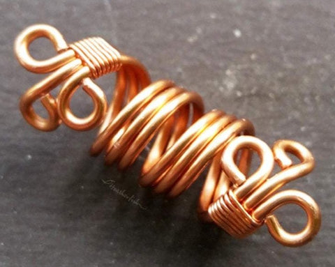 A Close up view of a Filigree Loc Bead.