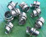 A close up view of Stylized Aluminum Dread Beads a Set of 10.