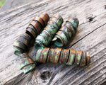 A side view of Patina Copper Dread Beads Set of 6.