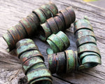 A close up view of Patina Copper Dread Beads Set of 6.