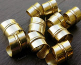 A close up view of Stylized Brass Dread Beads a Set of 10.