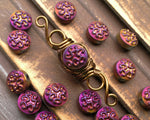A close up view of Purple Czech Glass Dread Bead.