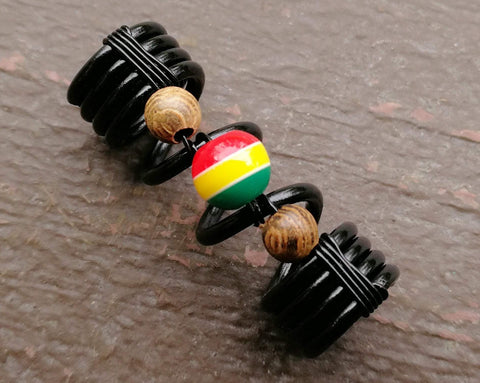 A close up view of a Striped Rasta Dread Bead.