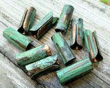 A top view of Green Patina Copper Tube Beads.