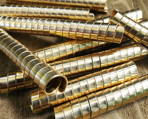A close up view of Long Brass Dread Beads Set of 10.
