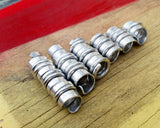 A roll of Hammered Dread Beads Set of 6.