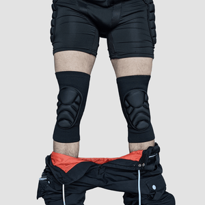 Front view of Snowboarder wearing protective padded knee pads