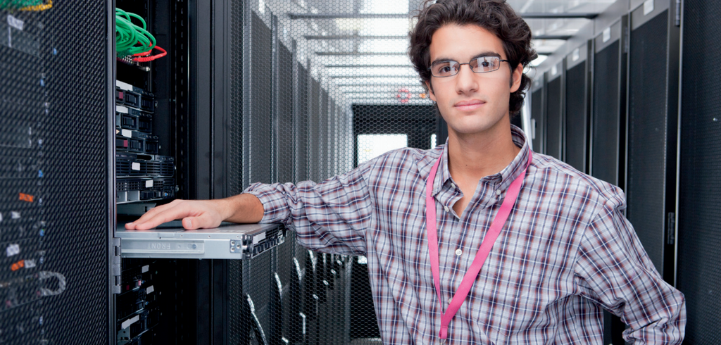 Picture of a man standing in the hot aisle of a data center