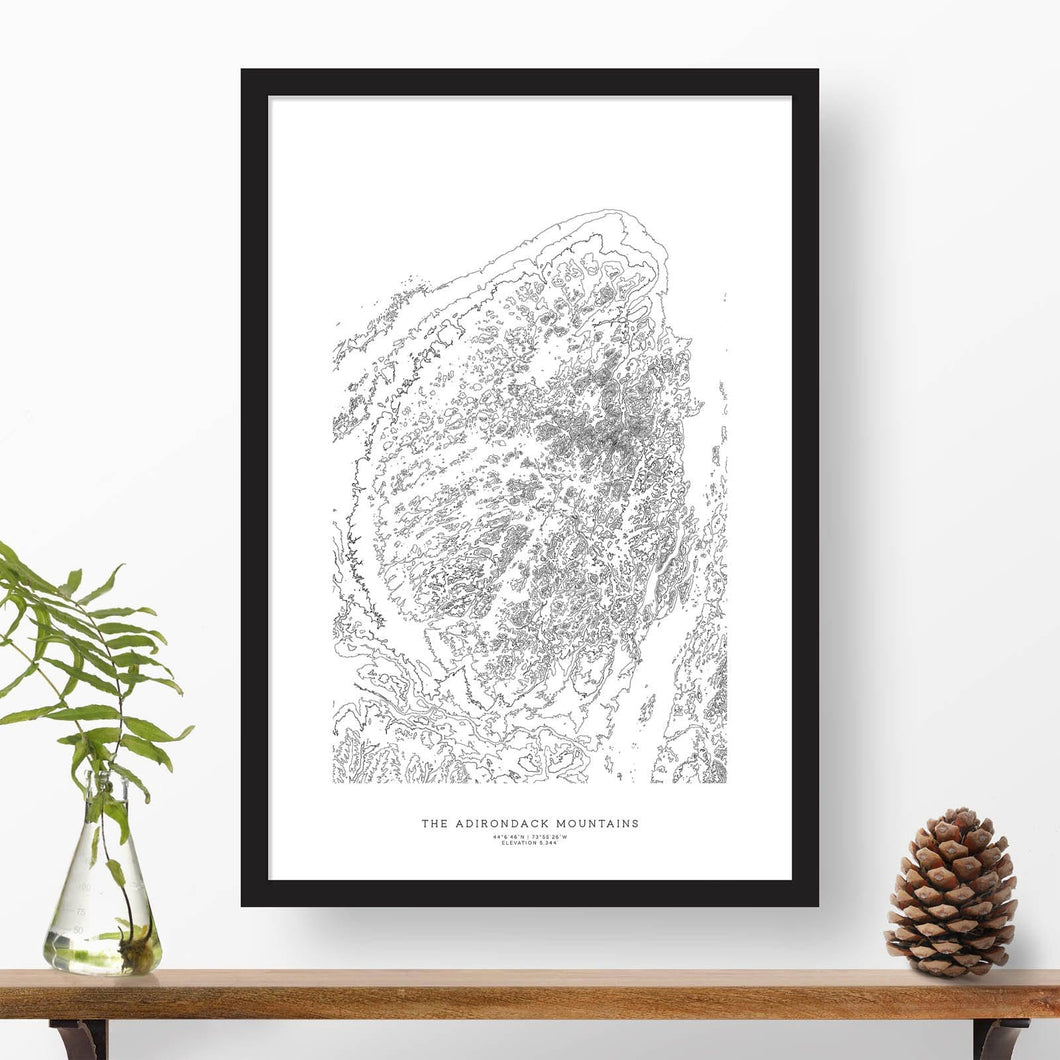Mountain art print of the Adirondack Mountains with black and white topography in a black 24x36 vertical frame.