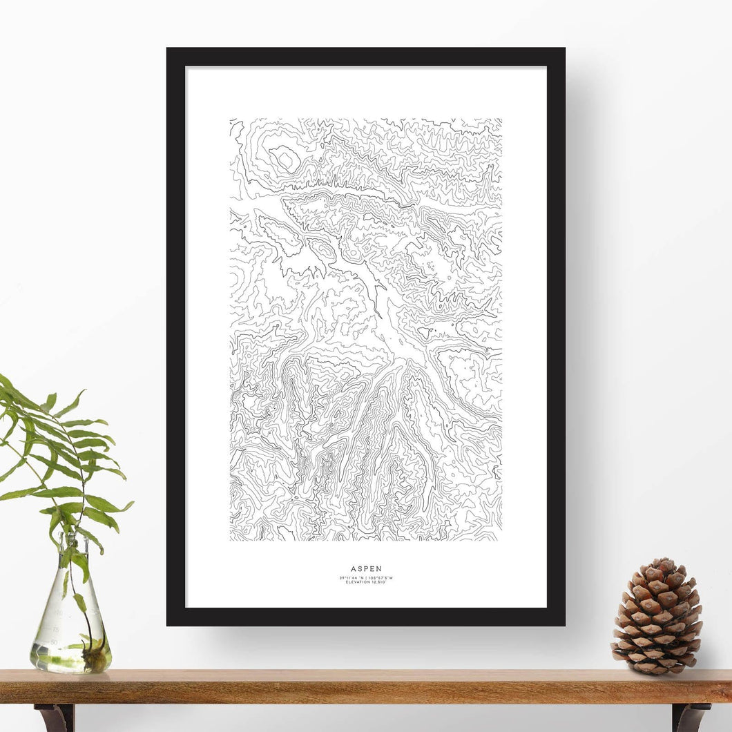 Black and white map and travel art of the Aspen, Colorado ski area. Topography contours are in black on a white background. Text below the image can be personalized for a perfect custom map art gift idea.