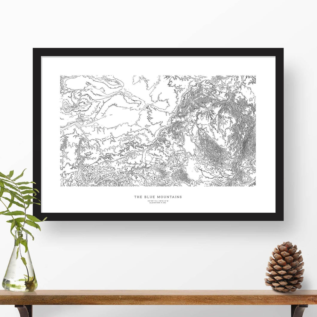 Blue Mountains (the Blues) in Washington and Oregon, featured in a topographic map poster, 24 inches by 36 inches, in a vertical orientation, with a black solid wood ready-to-hang frame.