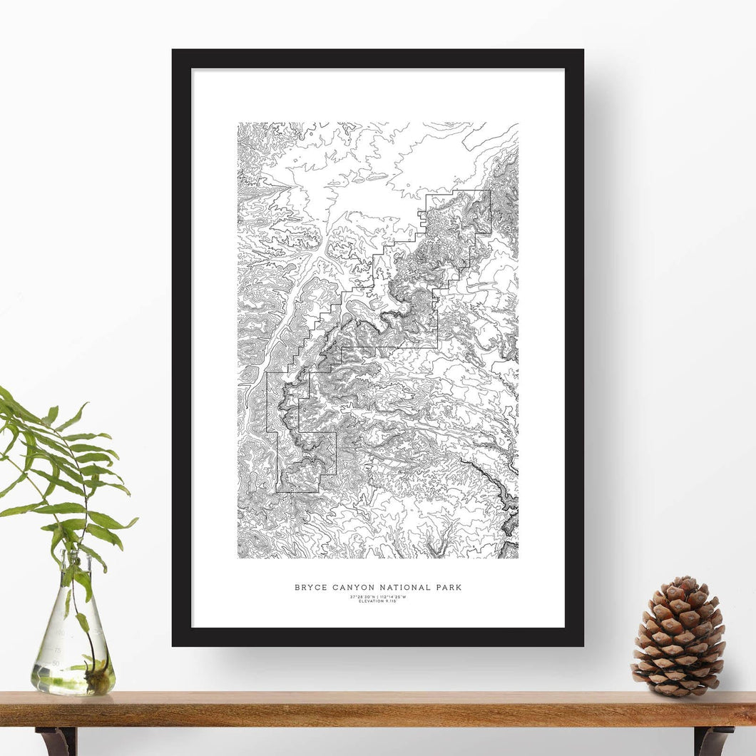 Black and white map and travel art of Bryce Canyon National Park. Topography contours are in black on a white background. Text below the image can be personalized for a perfect custom map art gift idea.