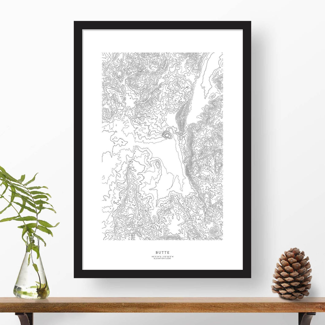 Print of Butte, Montana with black and white topography in a black 24x36 vertical frame.