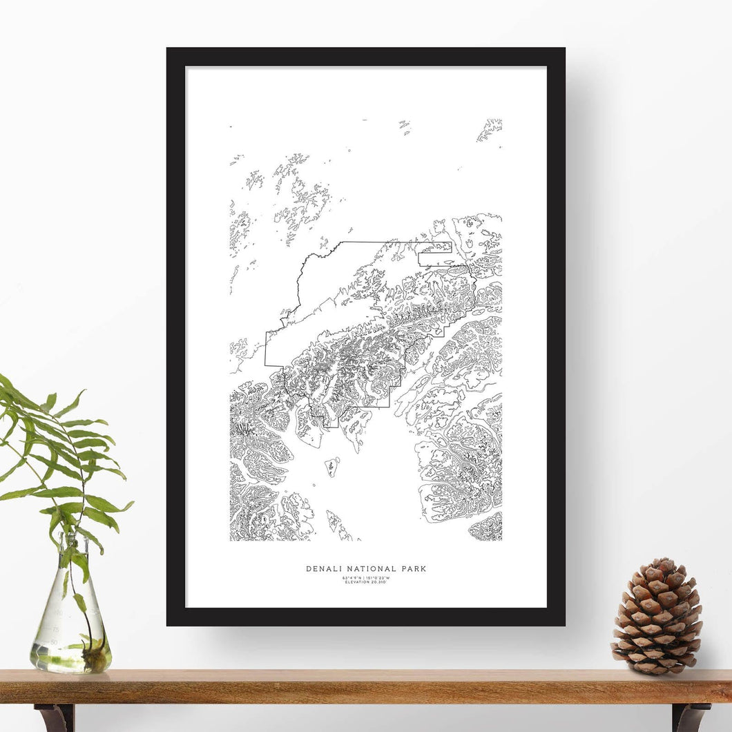 Black and white map and travel art of Denali National Park. Topography contours are in black on a white background. Text below the image can be personalized for a perfect custom map art gift idea.