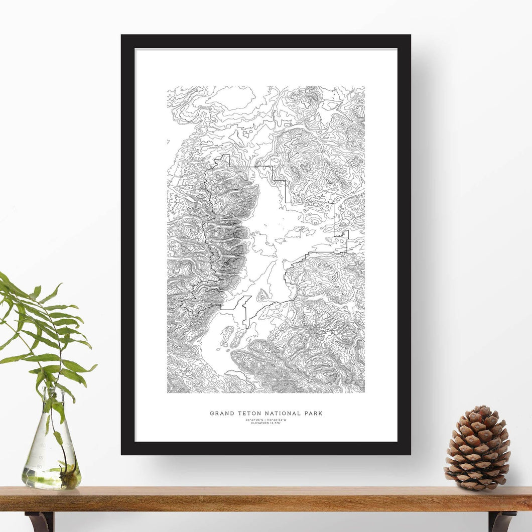 Grand Teton National Park topographic map poster, 24 inches by 36 inches, in a vertical orientation, with a black solid wood ready-to-hang frame.