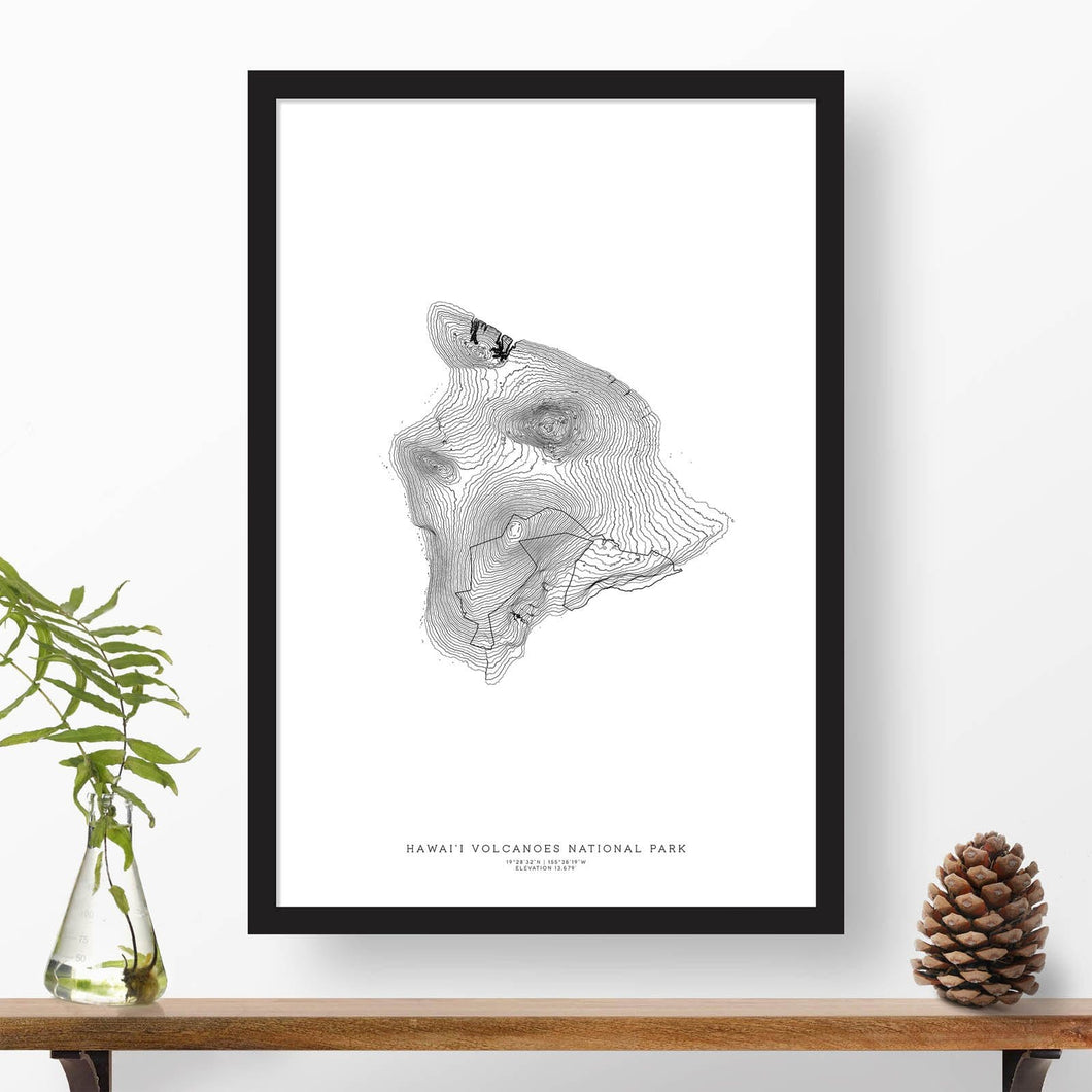 National park print of Hawai'i Volcanoes with black and white topography in a black 24x36 vertical frame.