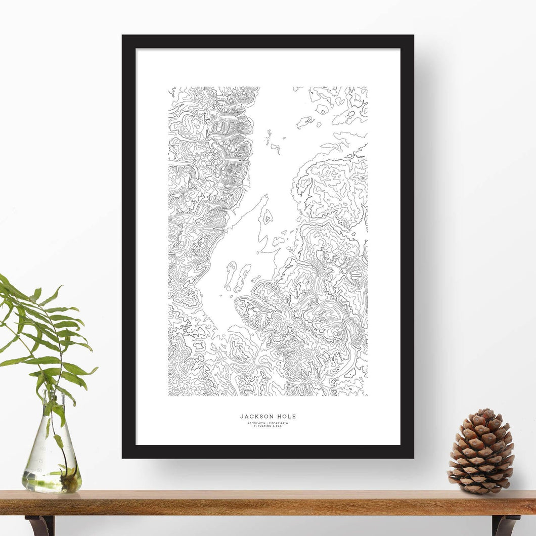 Topography map print print of Jackson Hole, Wyoming with black and white topography in a black 24x36 vertical frame.