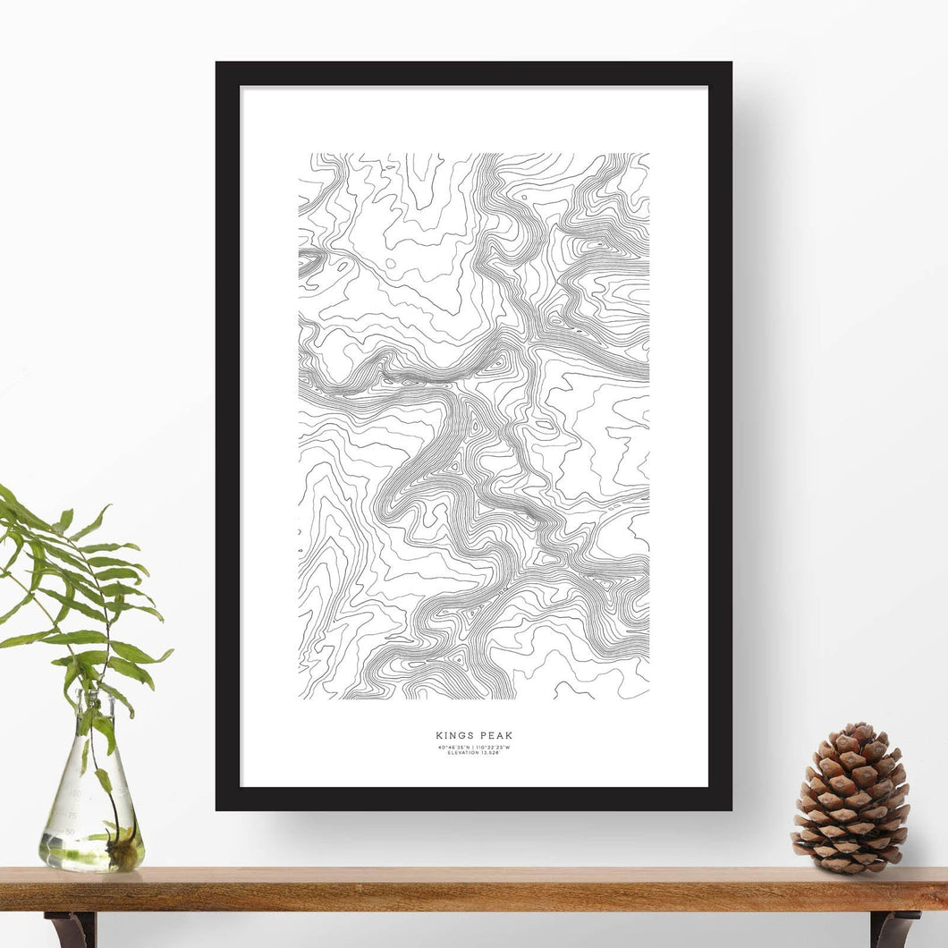 Black and white map and travel art of Kings Peak, Utah. Topography contours are in black on a white background. Text below the image can be personalized for a perfect custom map art gift idea.