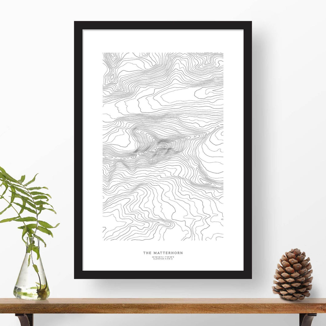 Print of the Matterhorn, Switzerland with black and white topography in a black 24x36 vertical frame.