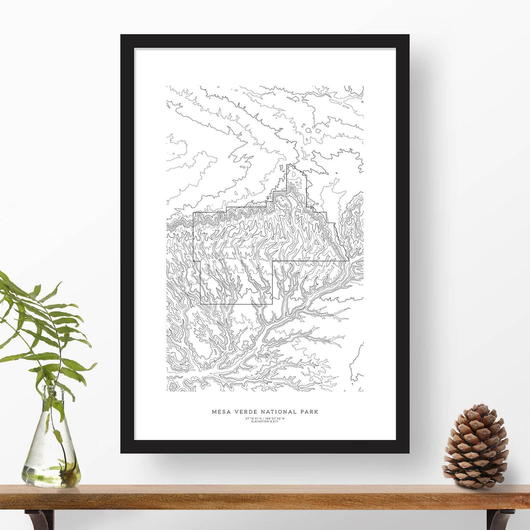 Black and white map and travel art of Mesa Verde National Park. Topography contours are in black on a white background. Text below the image can be personalized for a perfect custom map art gift idea.
