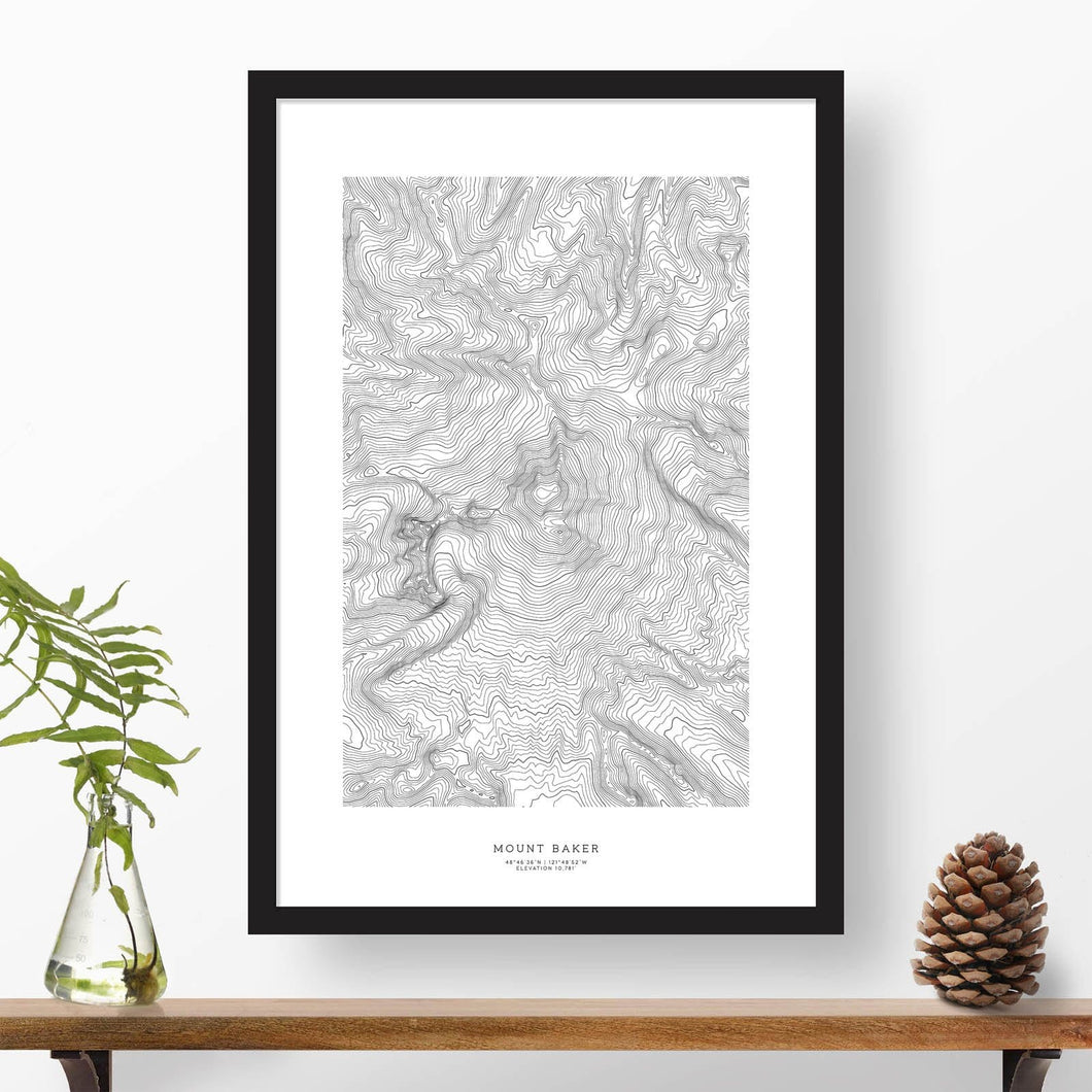 Mountain art print of Mount Baker with black and white topography in a black 24x36 vertical frame.