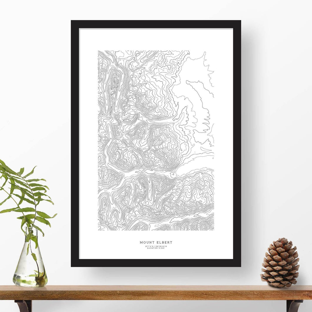 Black and white map and travel art of Mount Elbert, Colorado. Topography contours are in black on a white background. Text below the image can be personalized for a perfect custom map art gift idea.