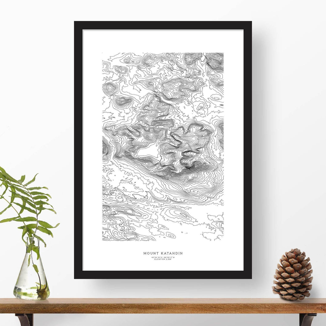 Black and white map and travel art of Mount Katahdin, Maine. Topography contours are in black on a white background. Text below the image can be personalized for a perfect custom map art gift idea.