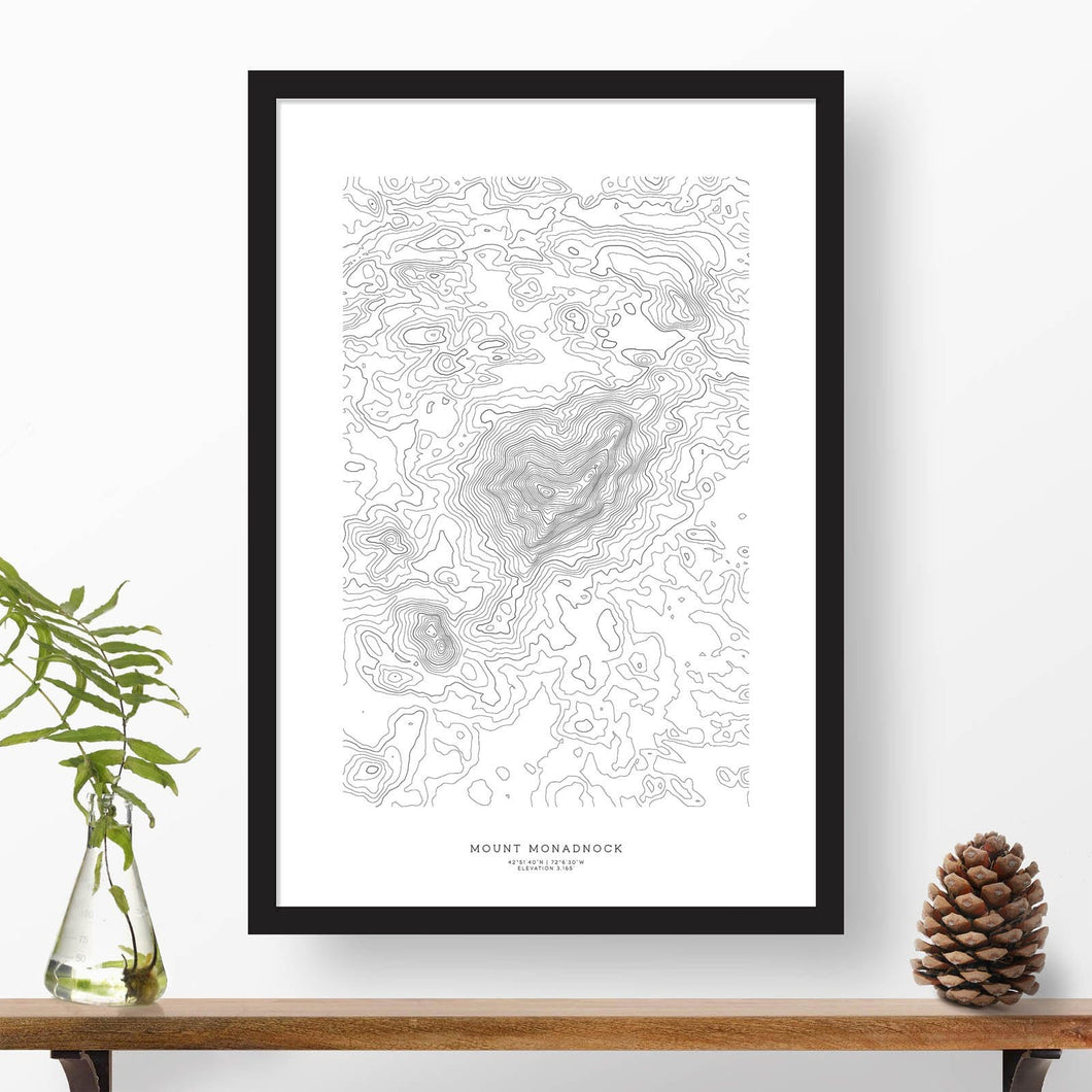 Black and white map and travel art of Mount Monadnock, New Hampshire. Topography contours are in black on a white background. Text below the image can be personalized for a perfect custom map art gift idea.