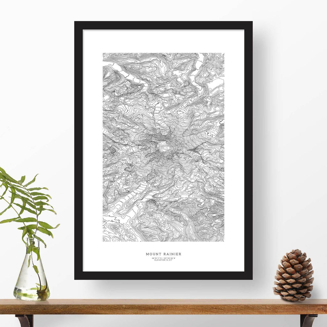 Mountain art print of Mount Rainier with black and white topography in a black 24x36 vertical frame.