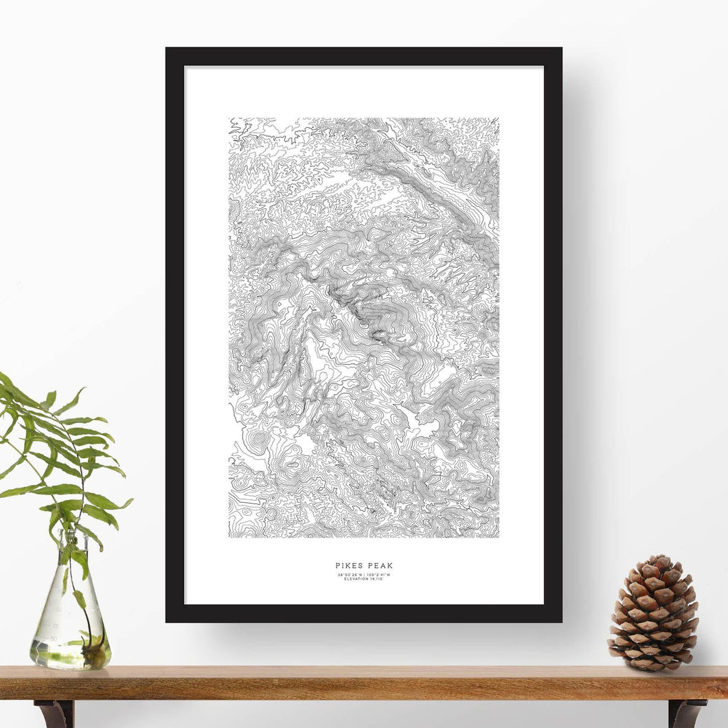 Black and white map and travel art of Pikes Peak, Colorado. Topography contours are in black on a white background. Text below the image can be personalized for a perfect custom map art gift idea.