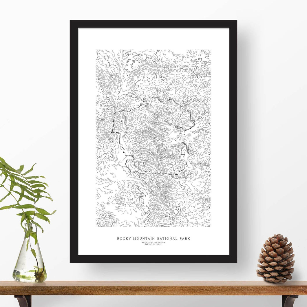 National park print of Rocky Mountain National Park with black and white topography in a black 24x36 vertical frame.