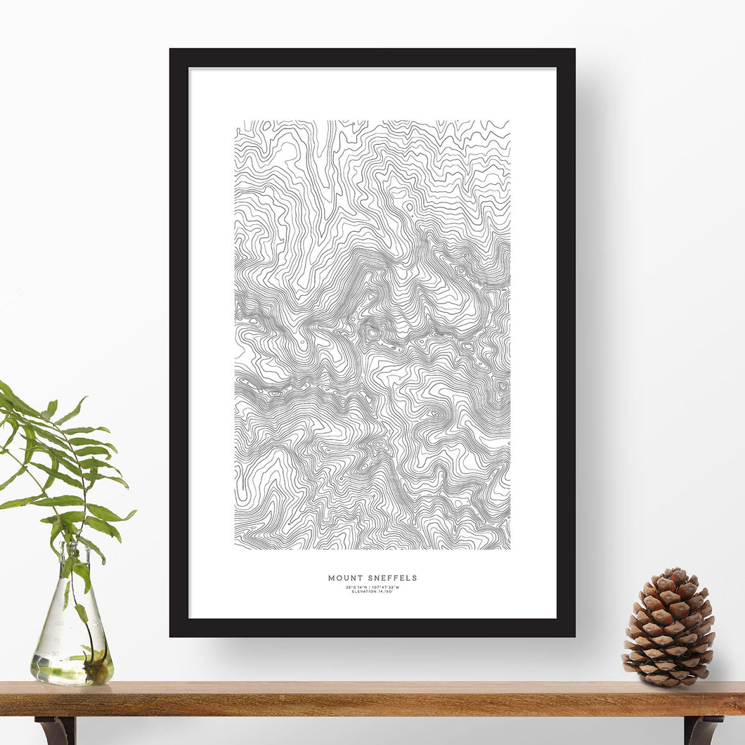 Black and white map and travel art of Mount Sneffels, Colorado. Topography contours are in black on a white background. Text below the image can be personalized for a perfect custom map art gift idea.