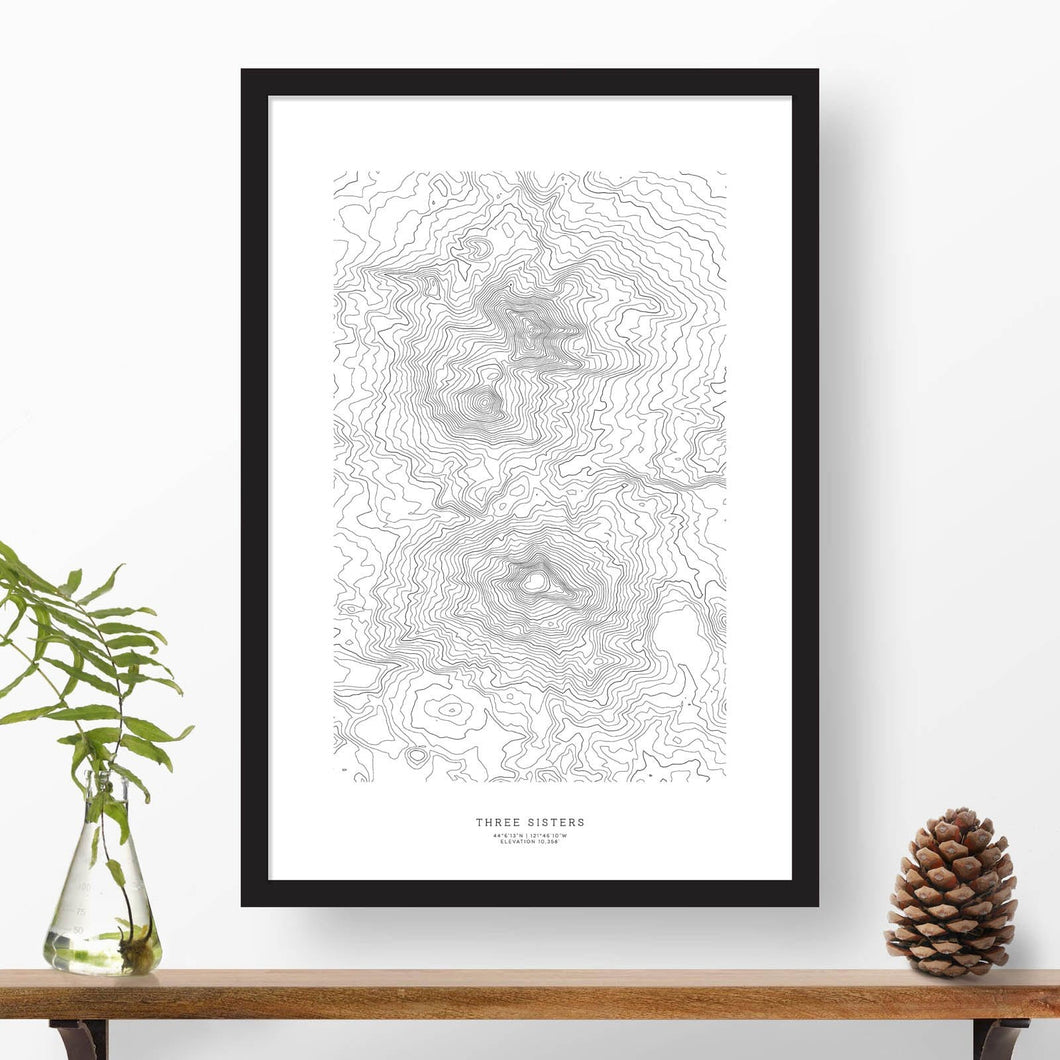 Three Sisters, Oregon topographic map poster, 24 inches by 36 inches, in a vertical orientation, with a black solid wood ready-to-hang frame.