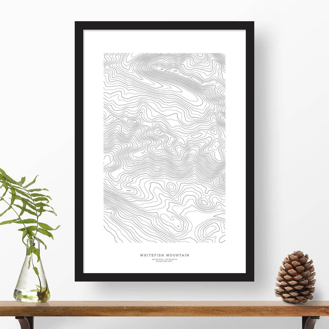 National park print of Whitefish Mountain, Montana with black and white topography in a black 24x36 vertical frame.