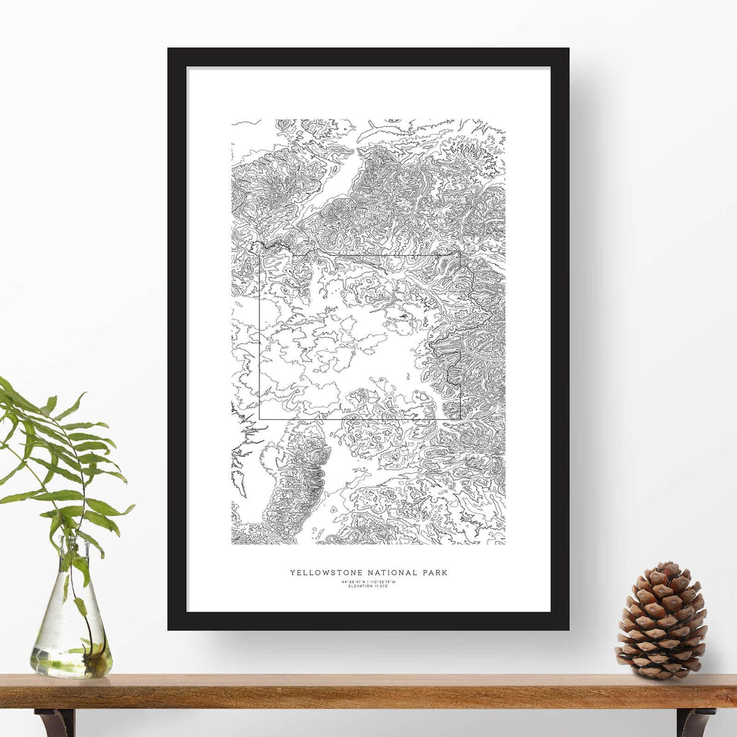 National park print of Yellowstone National Park with black and white topography in a black 24x36 vertical frame.