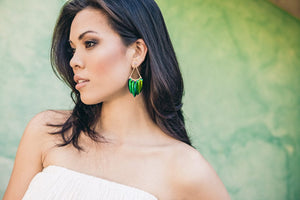 scarab beetle wing chandelier style earrings on model